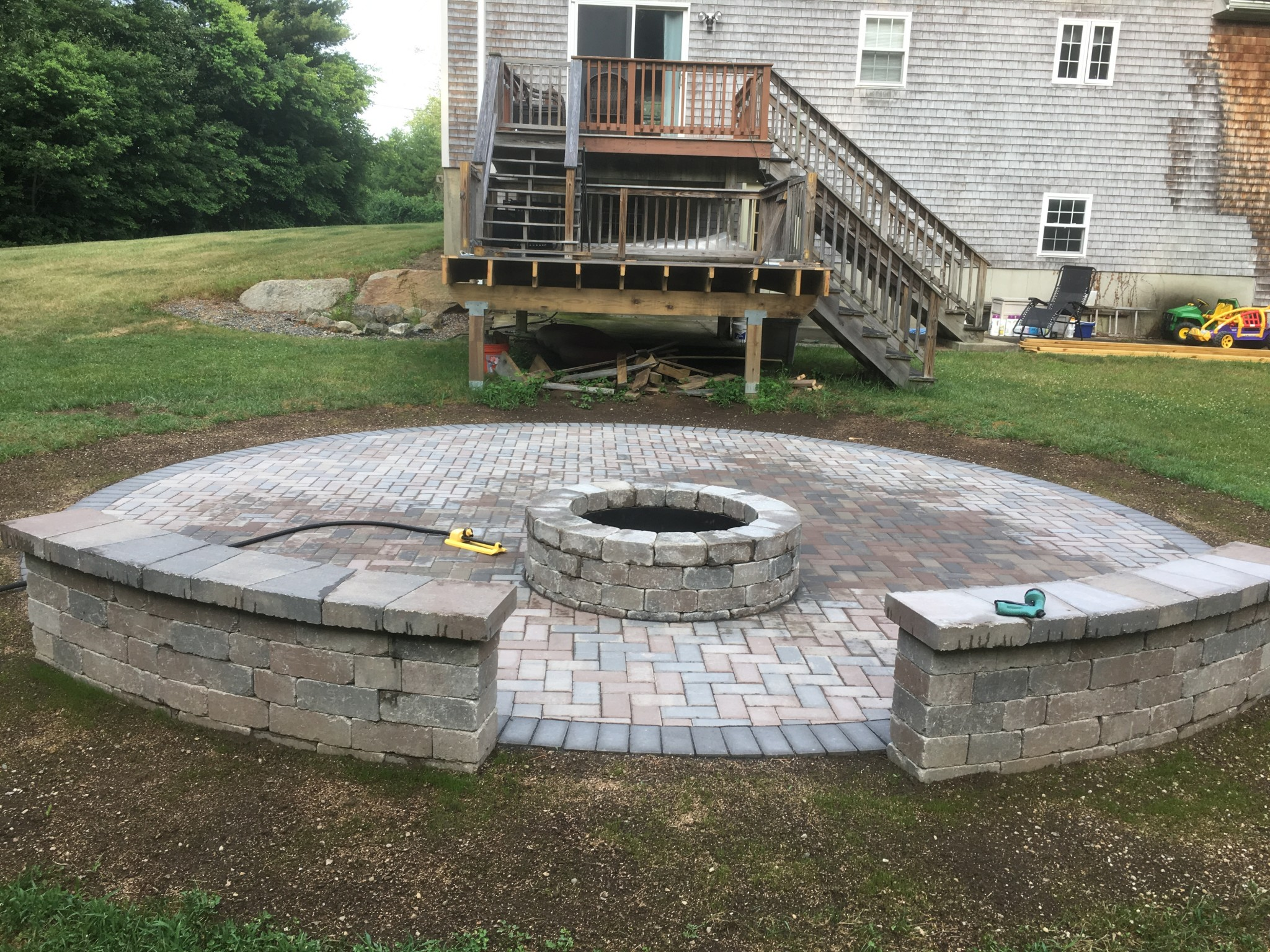 Fire Pit with Seating Wall Four Seasons Landscape & Hardscape Inc